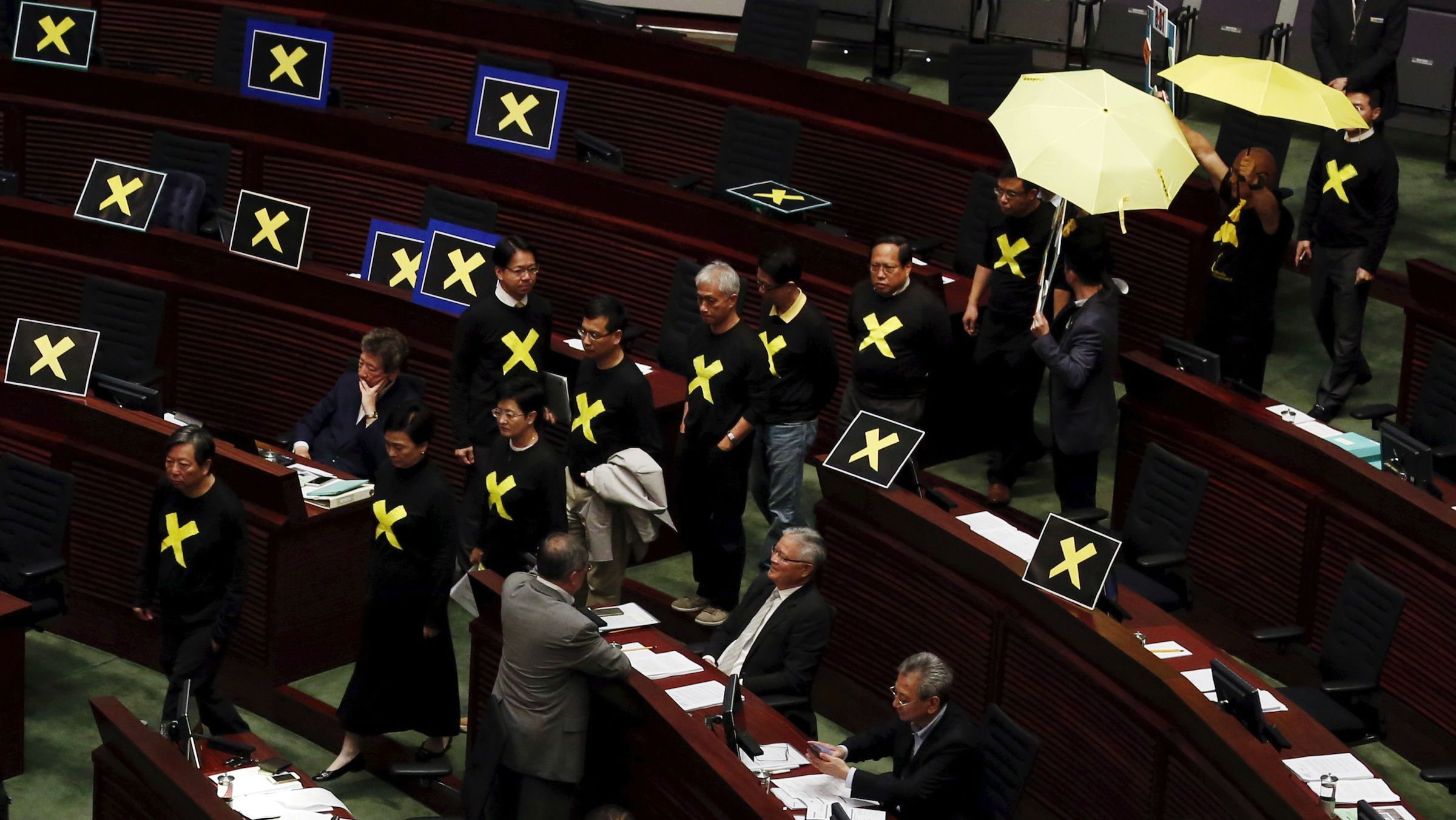 Hong Kong lawmakers protest electoral reform plan
