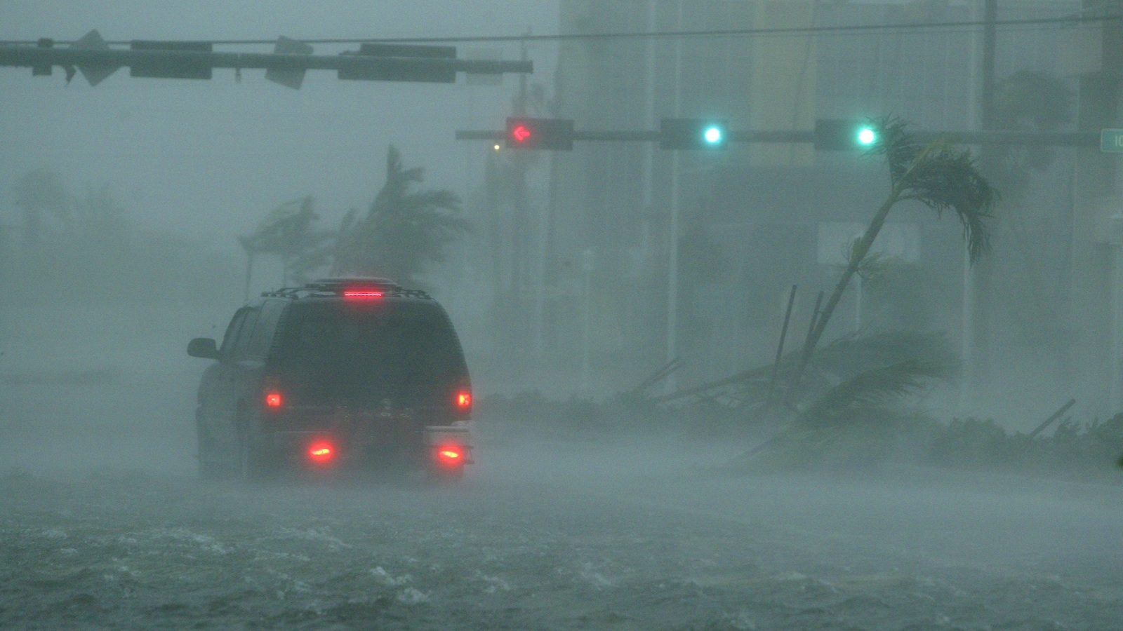 An SUV passes through flooding in downtown Naples, Florida, as Hurricane Wilma passes over the city in Oct. 2005.