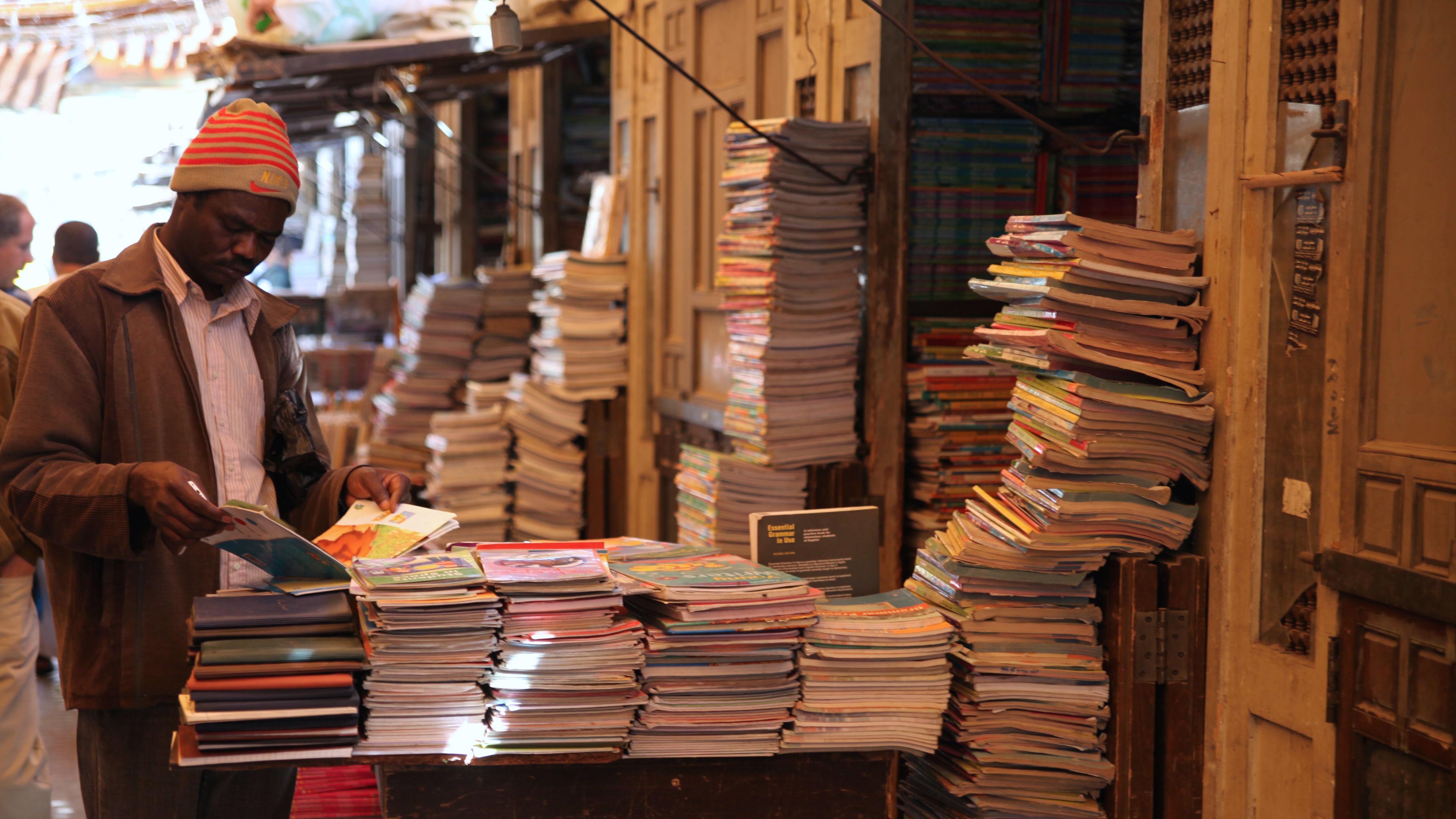 A man browses a stall at Cairo's Ezbekiya book market