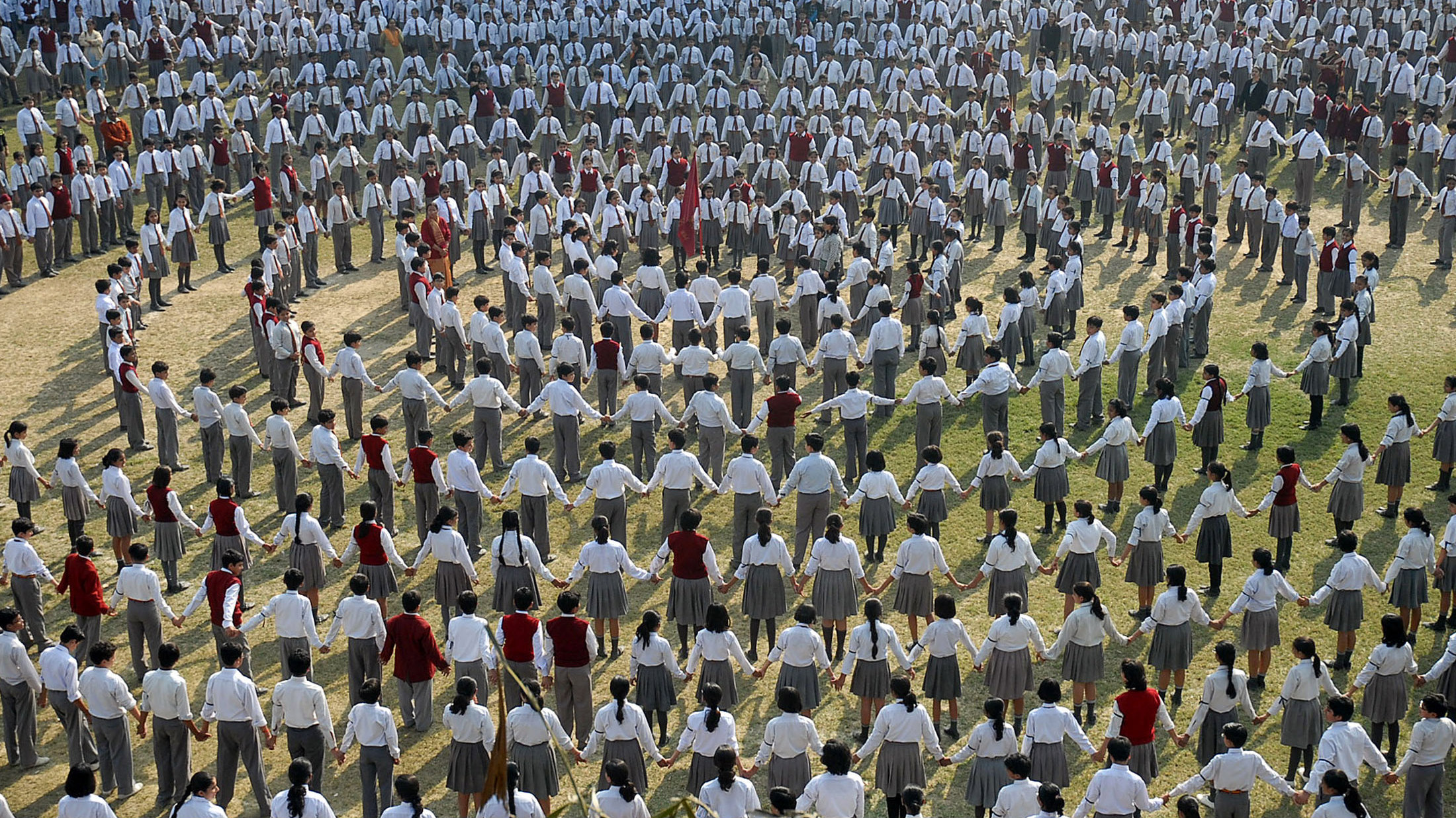 Students and teachers make a human chain inside the premises of their school to pay homage to the victims of Mumbai's recent attacks, in the northern Indian city of Lucknow December 5, 2008. Several attackers may have survived the three-day siege of Mumbai that killed 171 people last week, analysts said.
