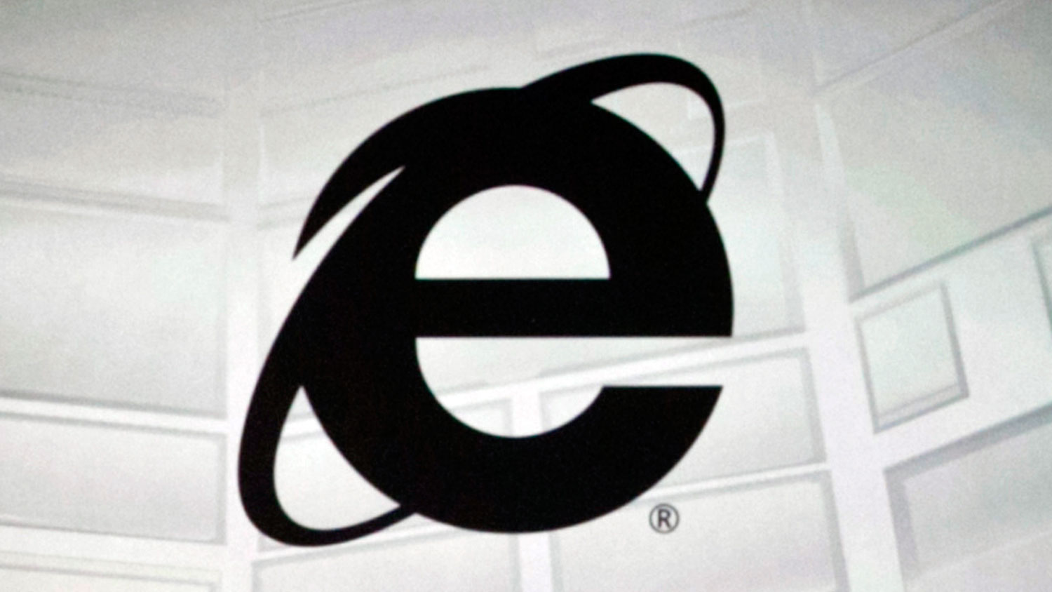 This June 4, 2012 photo shows the Microsoft Internet Explorer logo projected on a screen during the Microsoft Xbox E3 media briefing in Los Angeles. After 20 years of competing against rival web browsers, Microsoft is close to launching its own alternative to its once-dominant Internet surfing program.
