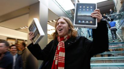 In this file photo taken April 3, 2010, Andres Schobel holds up two iPads as one of the first customers to buy iPads on the first day of Apple iPad sales at an Apple Store in San Francisco.