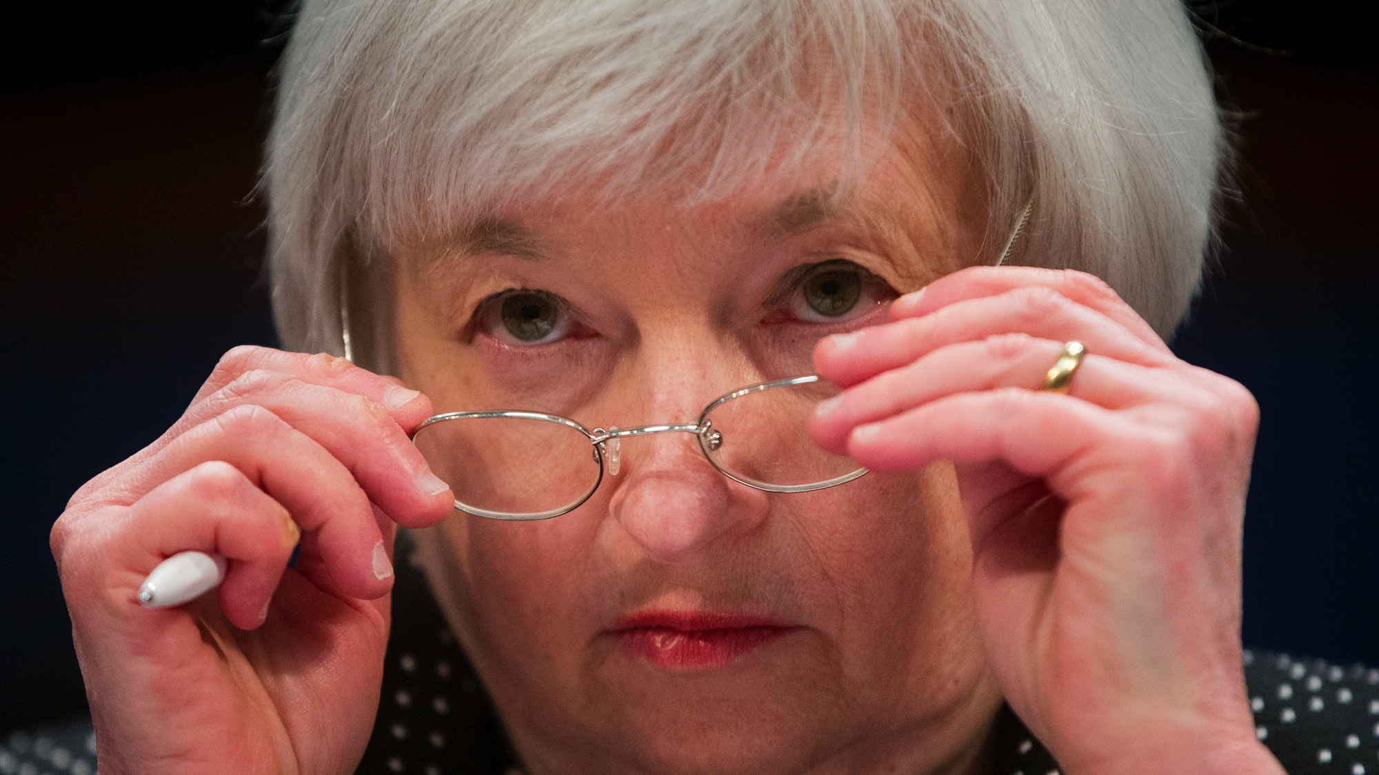 """Federal Reserve Chair Janet Yellen removes her glasses as she testifies on Capitol Hill in Washington, Wednesday, Feb. 25, 2015, before the House Financial Services Committee hearing: """"Monetary Policy and the State of the Economy."""