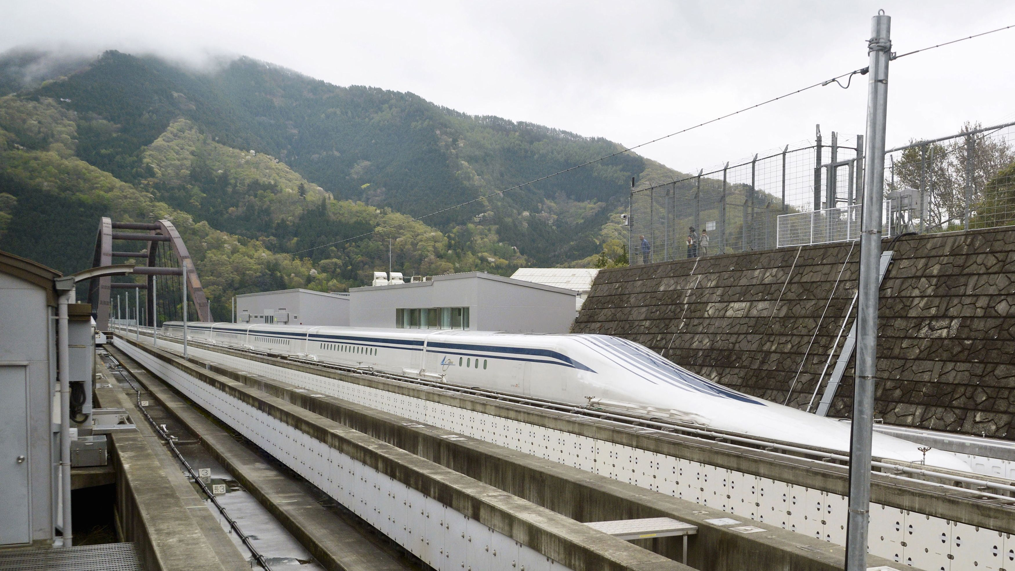 A magnetically levitating train operated by Central Japan Railway Co. making a test run is seen on an experimental track in Tsuru, Yamanashi Prefecture, in this photo taken by Kyodo April 21, 2015. Japan's experimental magnetically levitating train or maglev managed to break the new world speed record on Tuesday with a top speed of 603 kilometres (374 miles) per hour, Central Japan Railway, also known as JR Tokai said.   Mandatory credit REUTERS/Kyodo ATTENTION EDITORS - FOR EDITORIAL USE ONLY. NOT FOR SALE FOR MARKETING OR ADVERTISING CAMPAIGNS. THIS IMAGE HAS BEEN SUPPLIED BY A THIRD PARTY. IT IS DISTRIBUTED, EXACTLY AS RECEIVED BY REUTERS, AS A SERVICE TO CLIENTS. MANDATORY CREDIT. JAPAN OUT. NO COMMERCIAL OR EDITORIAL SALES IN JAPAN.  TPX IMAGES OF THE DAY.	  - RTX19LKK