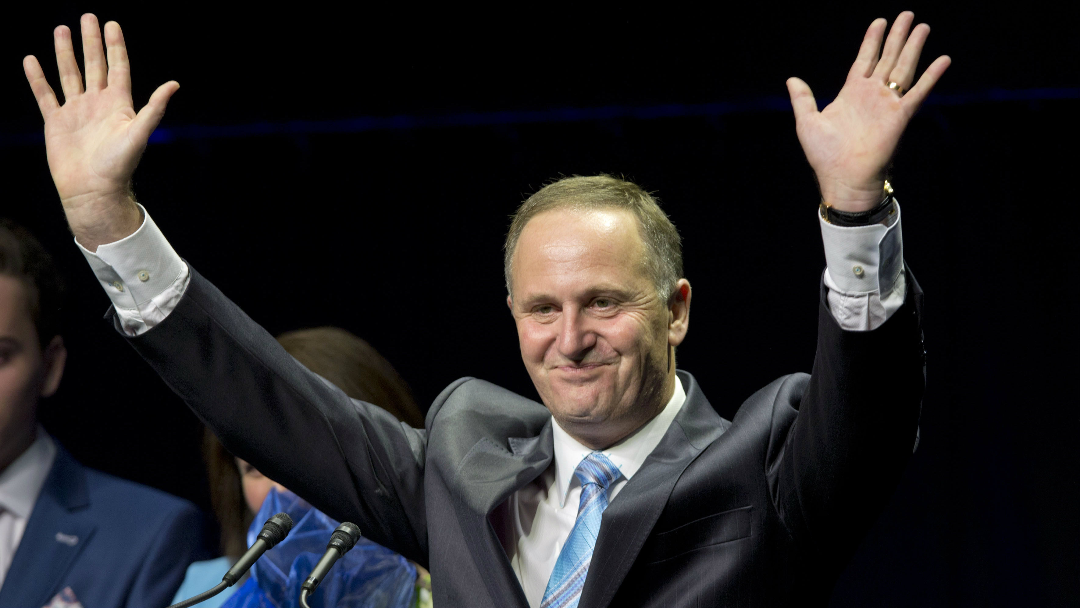 New Zealand Prime Minister John Key waves as he makes a speech after winning the national election in Auckland, New Zealand, Saturday, Sept. 20, 2014. Key won an emphatic victory in New Zealand's general election to return for a third term in office, a result that will be seen as an endorsement of the way Key's National Party has handled the economy. (AP Photo/New Zealand Herald, Mark Mitchell)