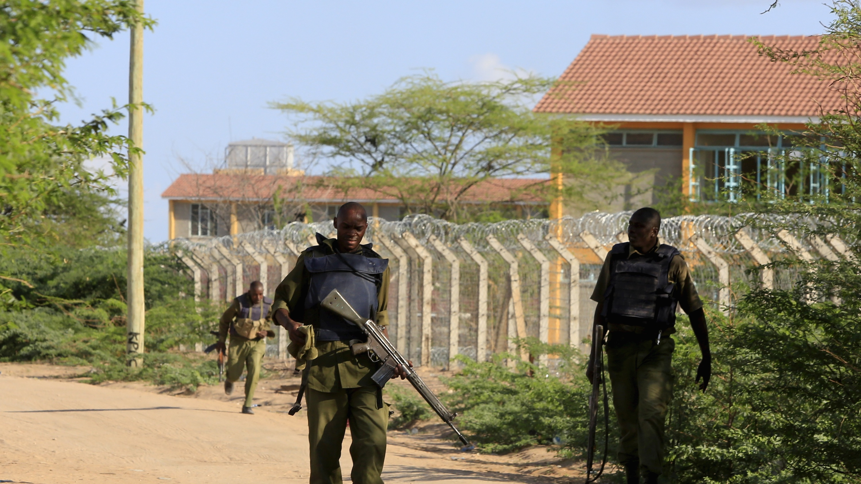 Kenyan security forces patrol the fenced border around Garissa University College.