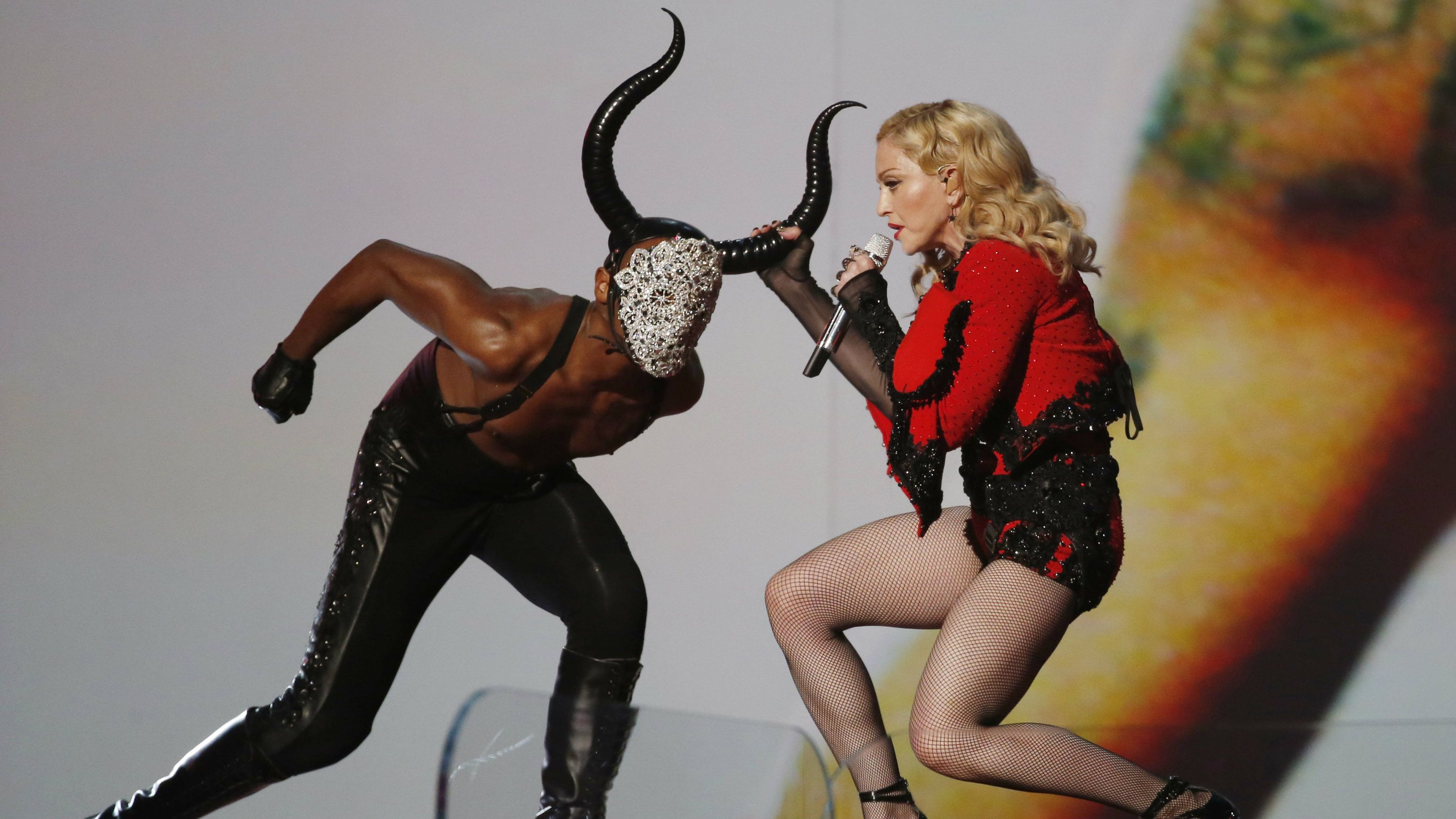 """Madonna performs """"Living for Love"""" at the 57th annual Grammy Awards in Los Angeles, California February 8, 2015."""