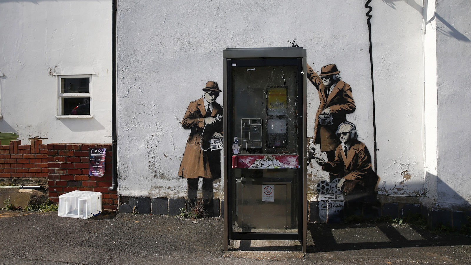 Graffiti art is seen on a wall near the headquarters of Britain's eavesdropping agency, Government Communications Headquarters, known as GCHQ, in Cheltenham, western England April 16, 2014. British media have attributed the new work to acclaimed British street artist Banksy, as a spoof on recent government spying scandals exposed by former U.S. National Security Agency contractor, Edward Snowden, who said that Britain's agency, GCHQ tapped fiber-optic cables carrying international phone and internet traffic and is sharing vast quantities of personal information with the NSA.  REUTERS/Eddie Keogh (BRITAIN - Tags: SOCIETY POLITICS) - RTR3LJKB