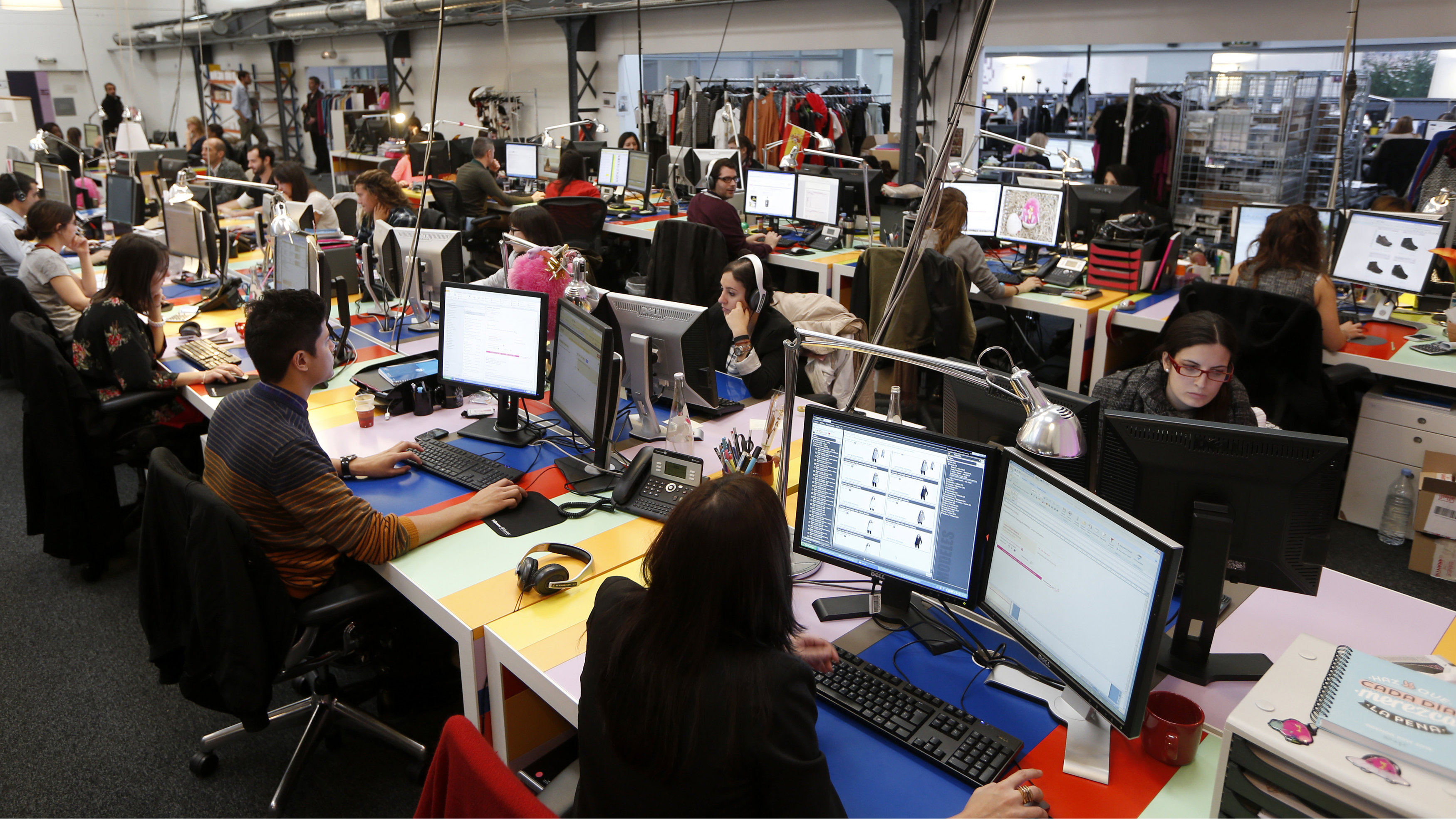 Employees work in front of their computers at the Vente-Privee.com company's headquarters in Saint-Denis near Paris October 24, 2013.