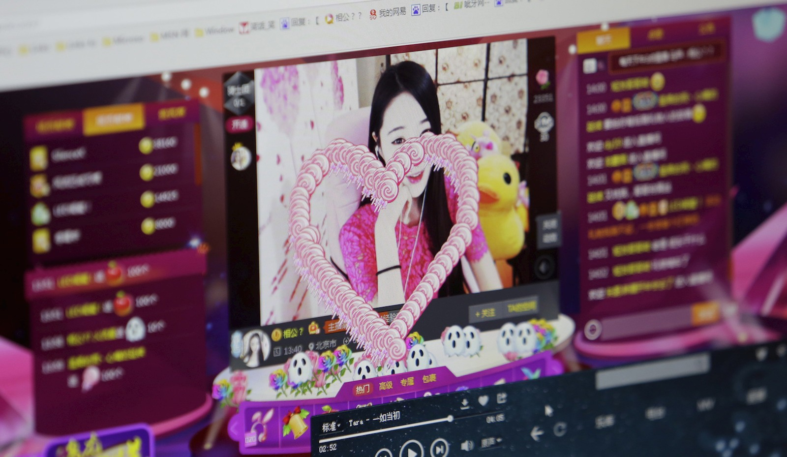 A digital gift is seen on the screen, which was bought and presented by a fan, as online hostess Xianggong gives a live broadcast in Beijing, February 10, 2015. In China's online hostessing world, men find virtual company and the women can find riches. Xianggong is one of more than 10,000 hostesses on the internet site bobo.com, a live broadcasting web platform where anyone can record themselves singing, playing piano, dancing or just chatting. REUTERS/Jason Lee   PICTURE 3 OF 27 FOR WIDER IMAGE STORY ëCHINAíS ONLINE HOSTESSESí  SEARCH 'XIANGGONGí FOR ALL IMAGES   - RTR4XJHT