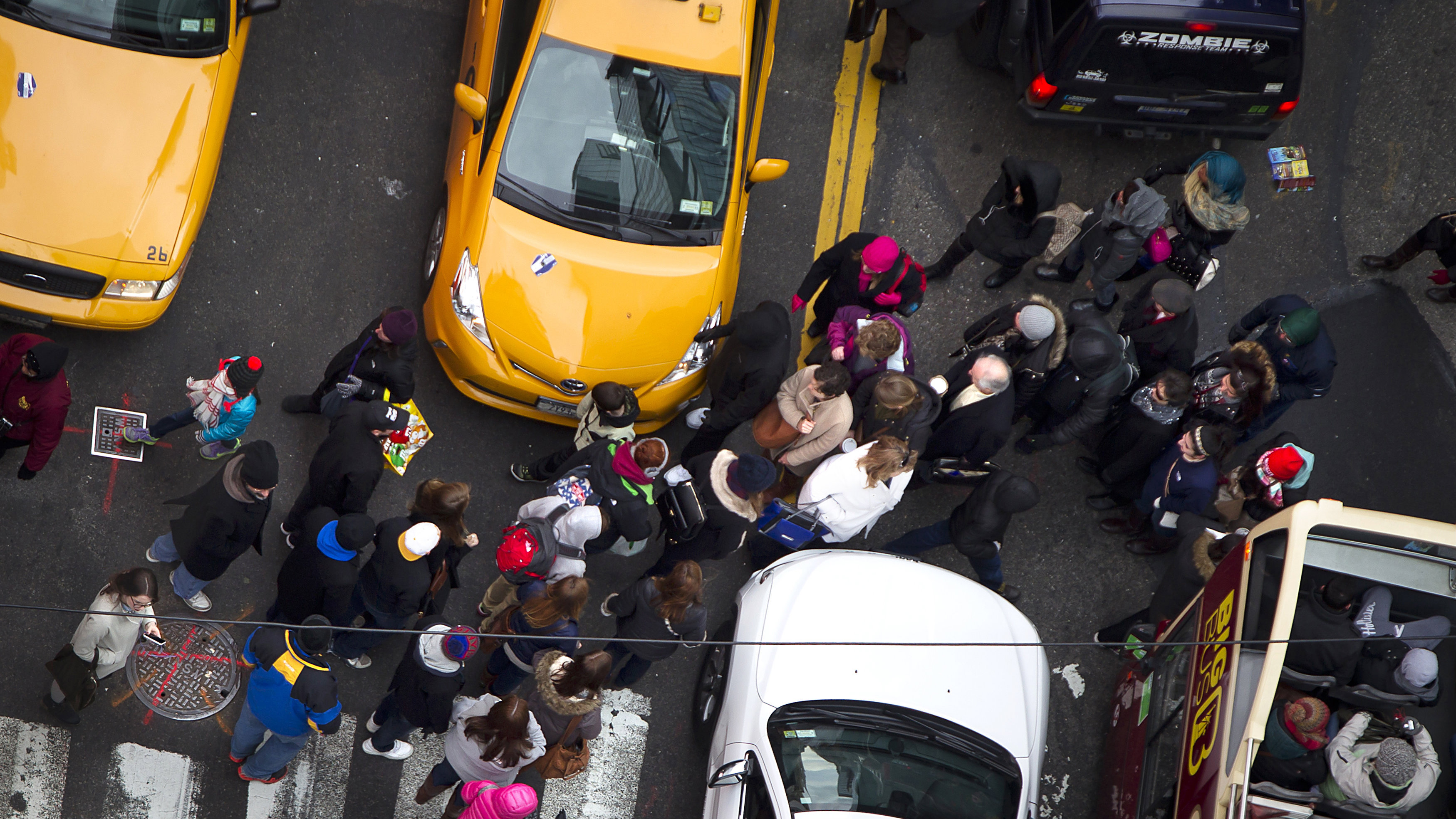 Pedestrians make their way though traffic in Times Square in New York December 30, 2014.
