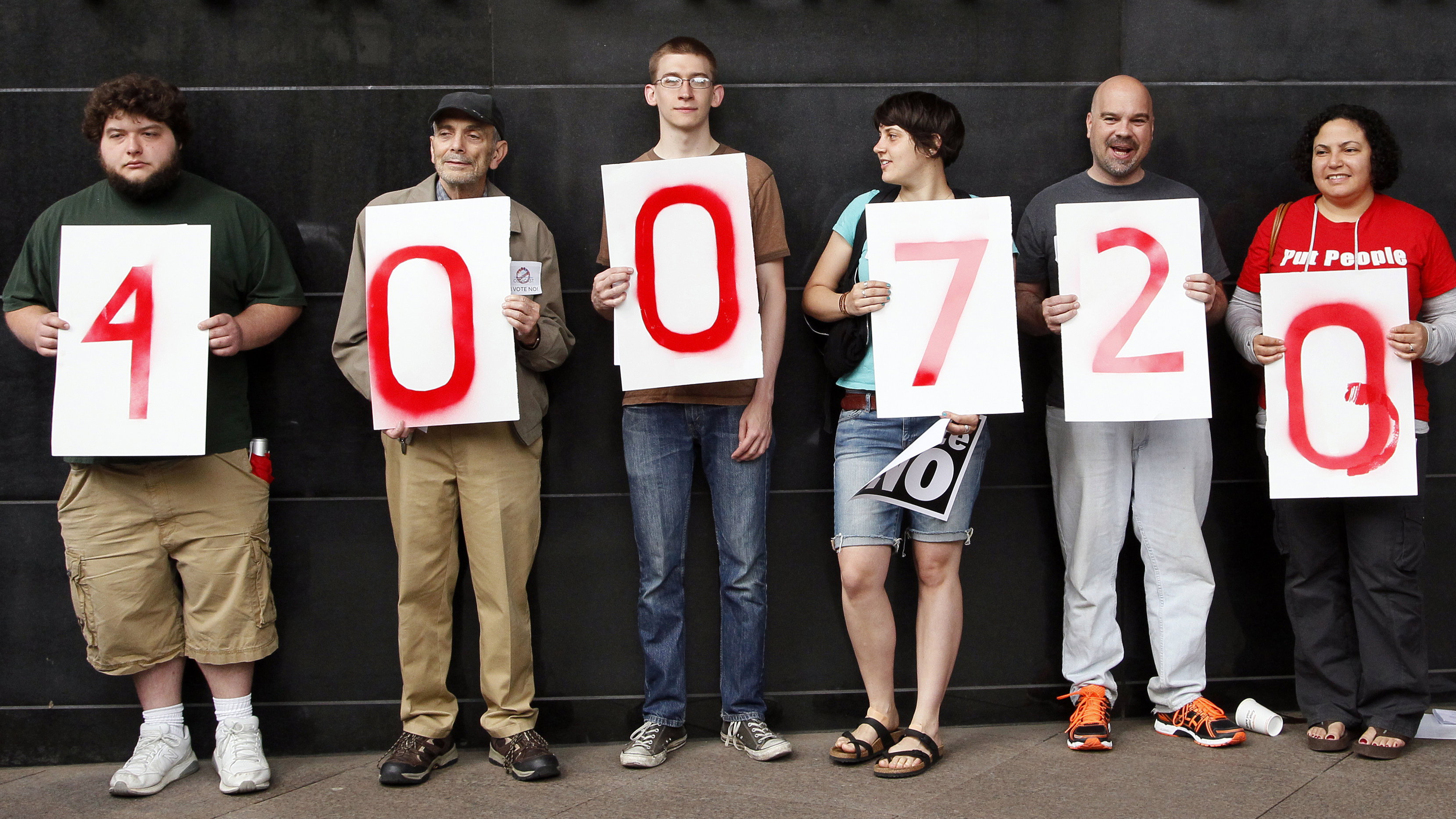 people holding numbers