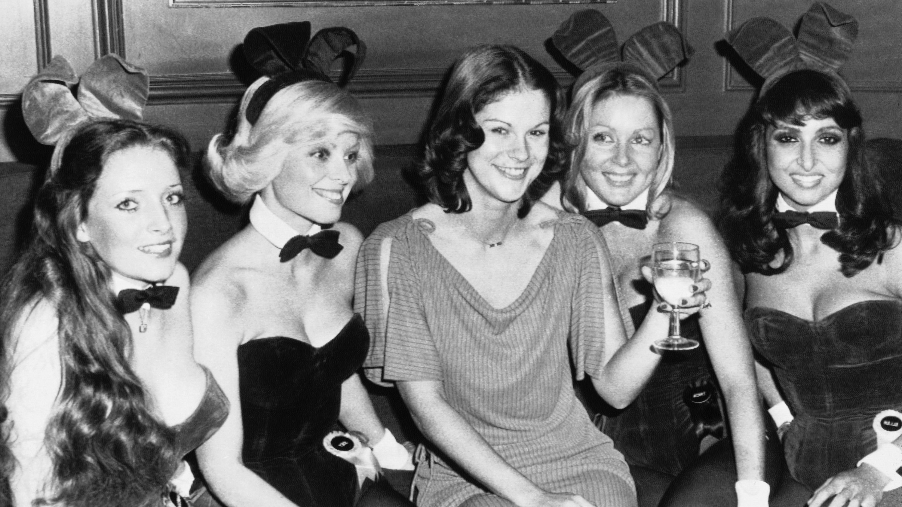 Christie Hefner, heiress to Playboy Enterprises Co., the 200 million dollar company, which began with the publication of Playboy Magazine in December 1953, in surrounded by Bunny girls during a welcome party at the Playboy Club in Londons Park Lane, Oct. 28, 1976, London, England. Christy, the 23 year-old daughter of Playboy King Hugh Hefner, flew in Wednesday from Chicago for a ten-day business trip. The bunnies are unidentified. (AP Photo)