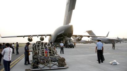 Relief material is loaded into an Indian Air Force aircraft headed to Nepal, in New Delhi, India, Saturday, April 25, 2015. A powerful earthquake struck Nepal Saturday and collapsed houses, leveled centuries-old temples and triggered avalanches on Mt. Everest. It was the worst tremor to hit the poor South Asian nation in over 80 years. (AP Photo/Rajesh Kumar)