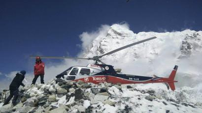 In this photo provided by Azim Afif, a helicopter prepares to rescue people from camp 1 and 2 at Everest Base Camp, Nepal on Monday, April, 27, 2015. On Saturday, a large avalanche triggered by Nepal's massive earthquake slammed into a section of the Mount Everest mountaineering base camp, killing a number of people and left others unaccounted for. Afif and his team of four others from the Universiti Teknologi Malaysia (UTM) all survived the avalanche. (Azim Afif via AP)