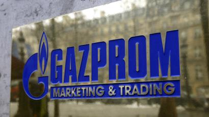 The logo of Gazprom marketing department is seen in front of an office.