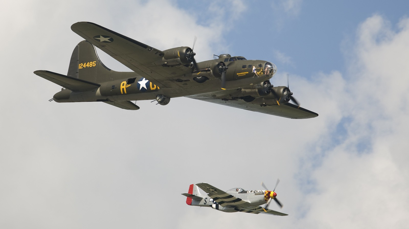 U.S. military planes from the World War II era B-17 Bomber (L) and and a P-51 fly over prior to the Coca-Cola 600 NASCAR race in Concord, North Carolina on May 30, 2010. REUTERS/Chris Keane (UNITED STATES - Tags: SPORT MOTOR RACING TRANSPORT) - RTR2EKME