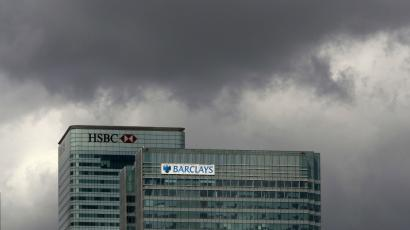 The HSBC and the Barclays buildings are seen in the Canary Wharf business district, in East London.