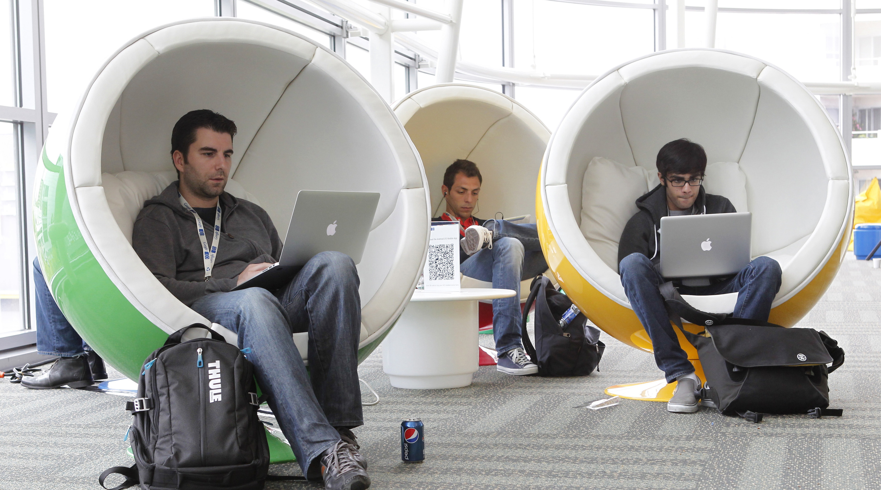 Matthias Klabbenbach (L), of eBay, Massimo Paladin (2nd L), of Cern, and Shahruz Shaukat, of University of California at Davis, take a break between events at the Google I/O Developers Conference in the Moscone Center in San Francisco, California, May 11, 2011.