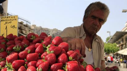 A greengrocer displays strawberries at his stall at Monastiraki market, central Athens.