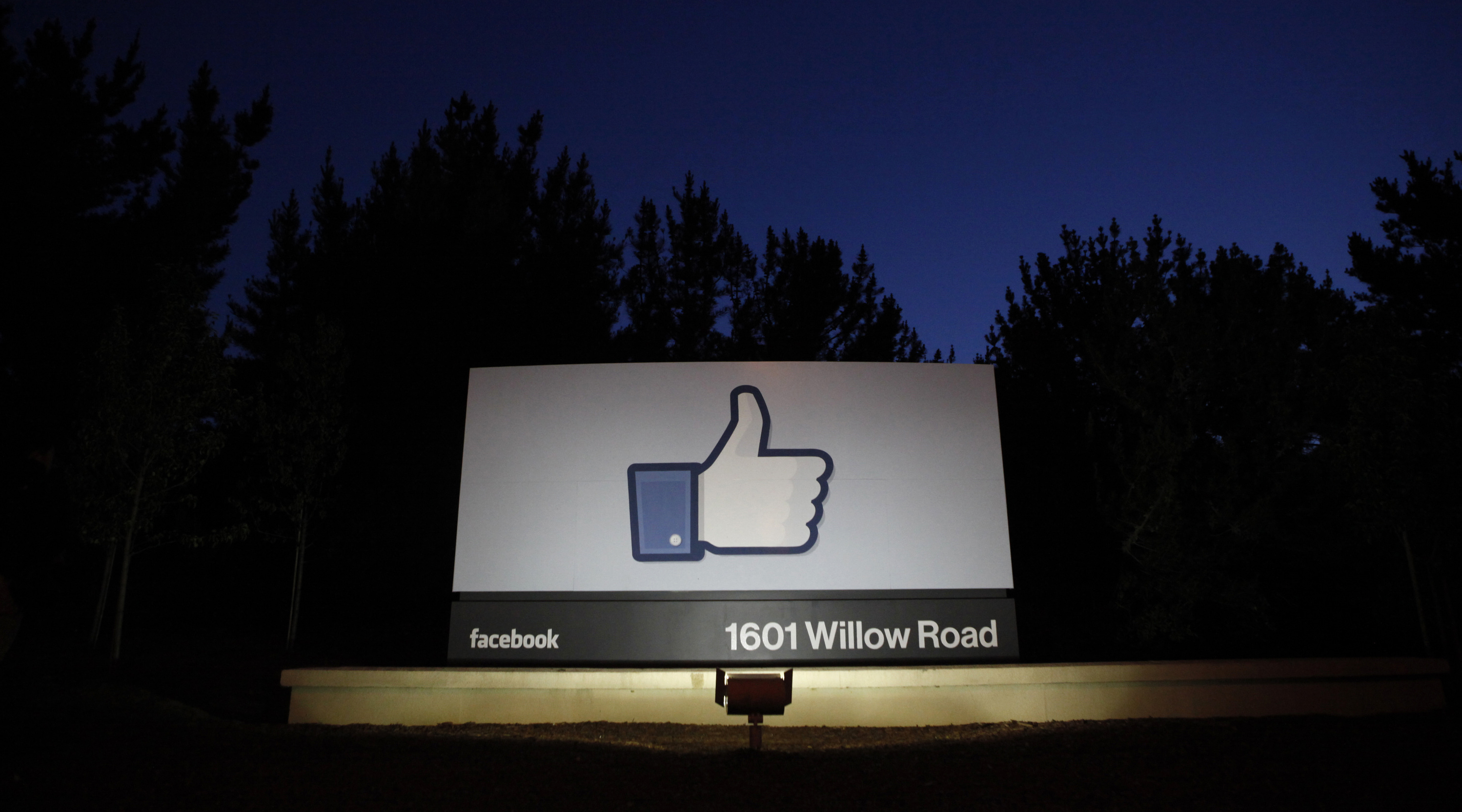 The sun rises behind the entrance sign to Facebook headquarters in Menlo Park before the company's IPO launch, May 18, 2012. Facebook Inc, will begin trading on the Nasdaq market on Friday, with it's initial public offering at $38 per share, valuing the world's largest social network at more than $100 billion.