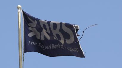 A flag flies above the head office of the Royal Bank of Scotland (RBS) in St Andrew Square in Edinburgh, Scotland.