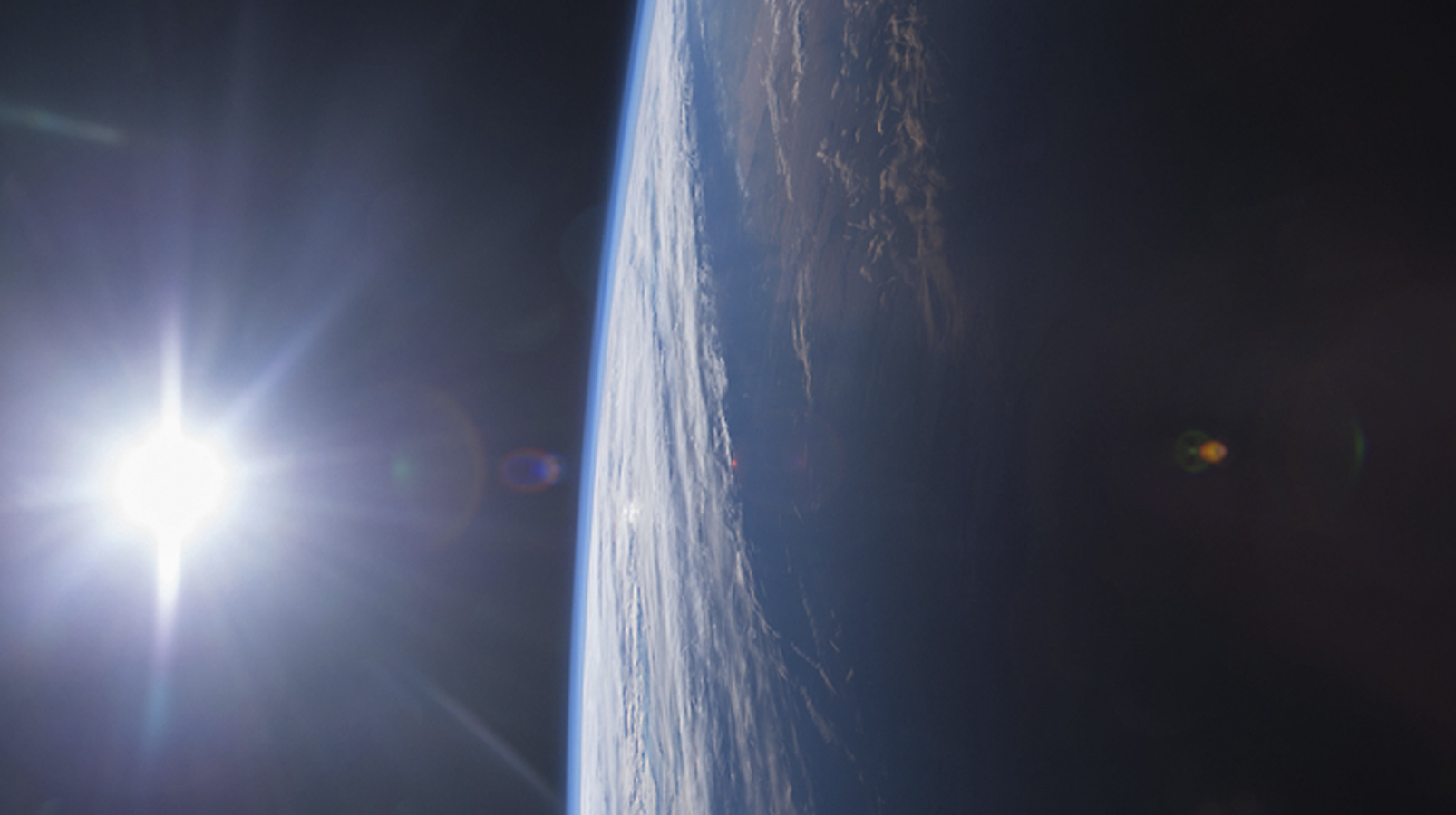 The Gulf of Mexico and U.S. Gulf Coast at sunset is shown in this image from the International Space Station and posted to social media on December 14, 2014. The space station and its crew orbit Earth from an altitude of 220 miles, traveling at a speed of approximately 17,500 miles per hour. Because the station completes each trip around the globe in about 92 minutes, the crew experiences 16 sunrises and sunsets each day.