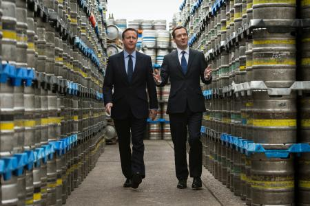 Britain's Prime Minister and Conservative Party leader David Cameron (L) walks with Chancellor George Osborne during their visit to Marston's Brewery in Wolverhampton, central England April 1, 2015. Britain will go to the polls in a national election on May 7.