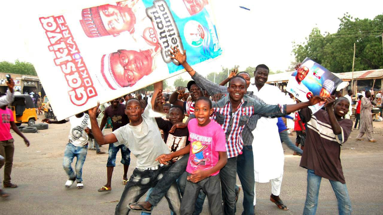 Supporters of presidential candidate Muhammadu Buhari and his All Progressive Congress party celebrate in Maiduguri.