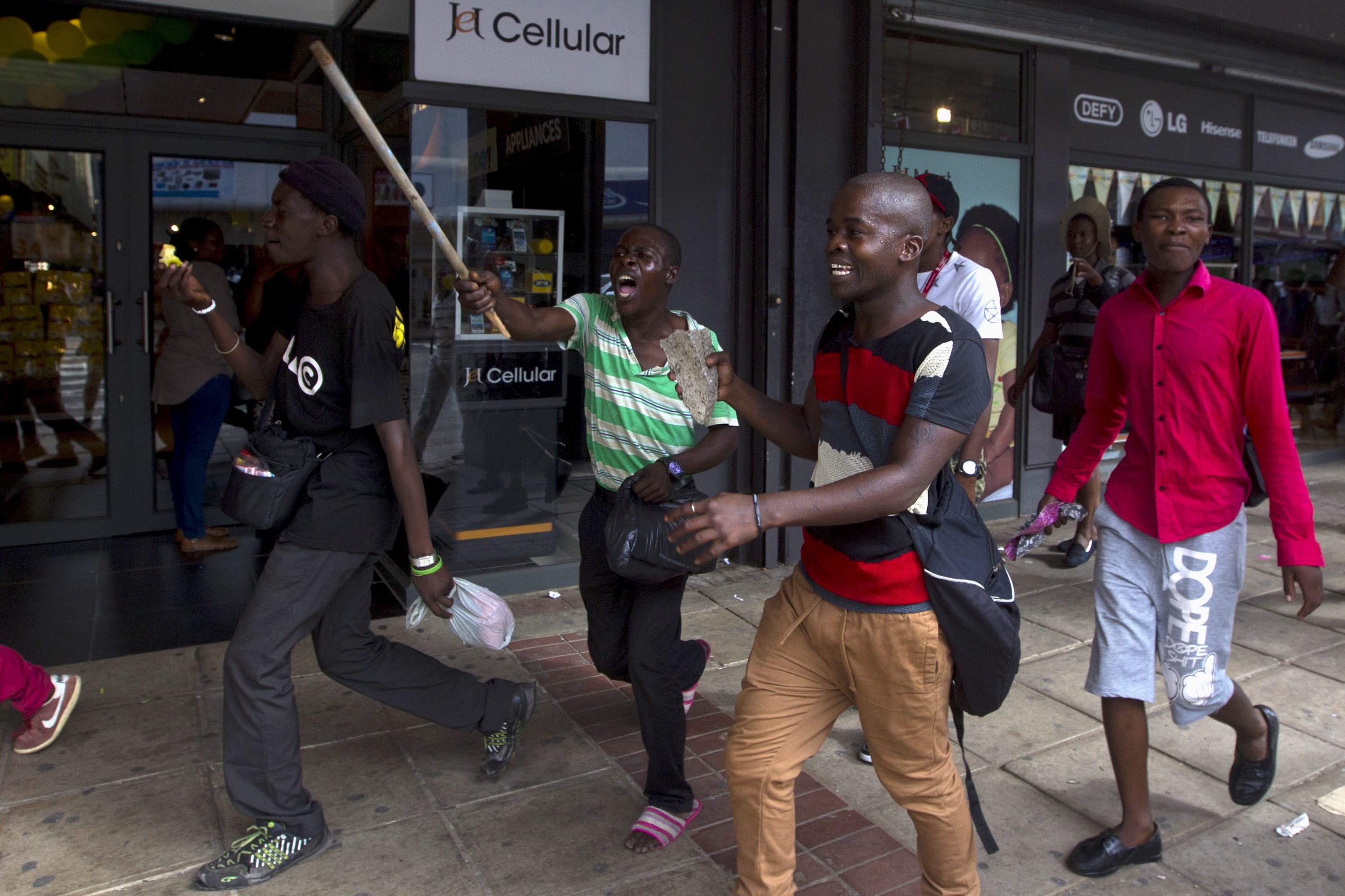 South African men run from police