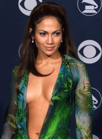 "Presenter and nominee Jennifer Lopez shows off her latest fashion at the 42nd annual Grammy Awards in Los Angeles February 23, 2000. Lopez was nominated for Best Dance Recording for her song ""Waiting For Tonight""."