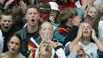 German soccer fans react after Ronaldo scored Brazil's 1-0 against Germany in the World Cup Finals in Japan.