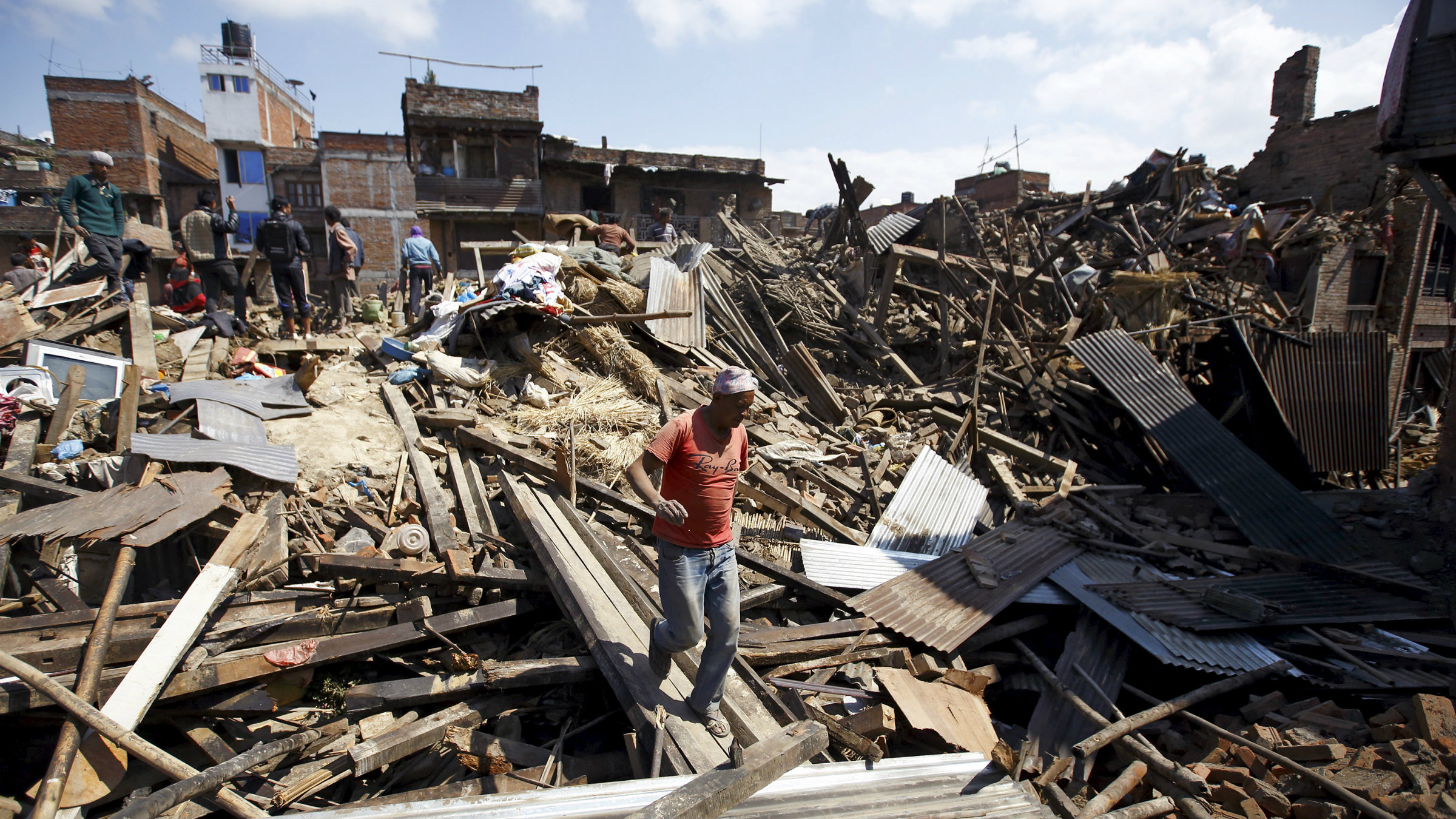 A man walks on the rubble of collapsed houses following Saturday's earthquake in Bhaktapur, Nepal April 27, 2015.