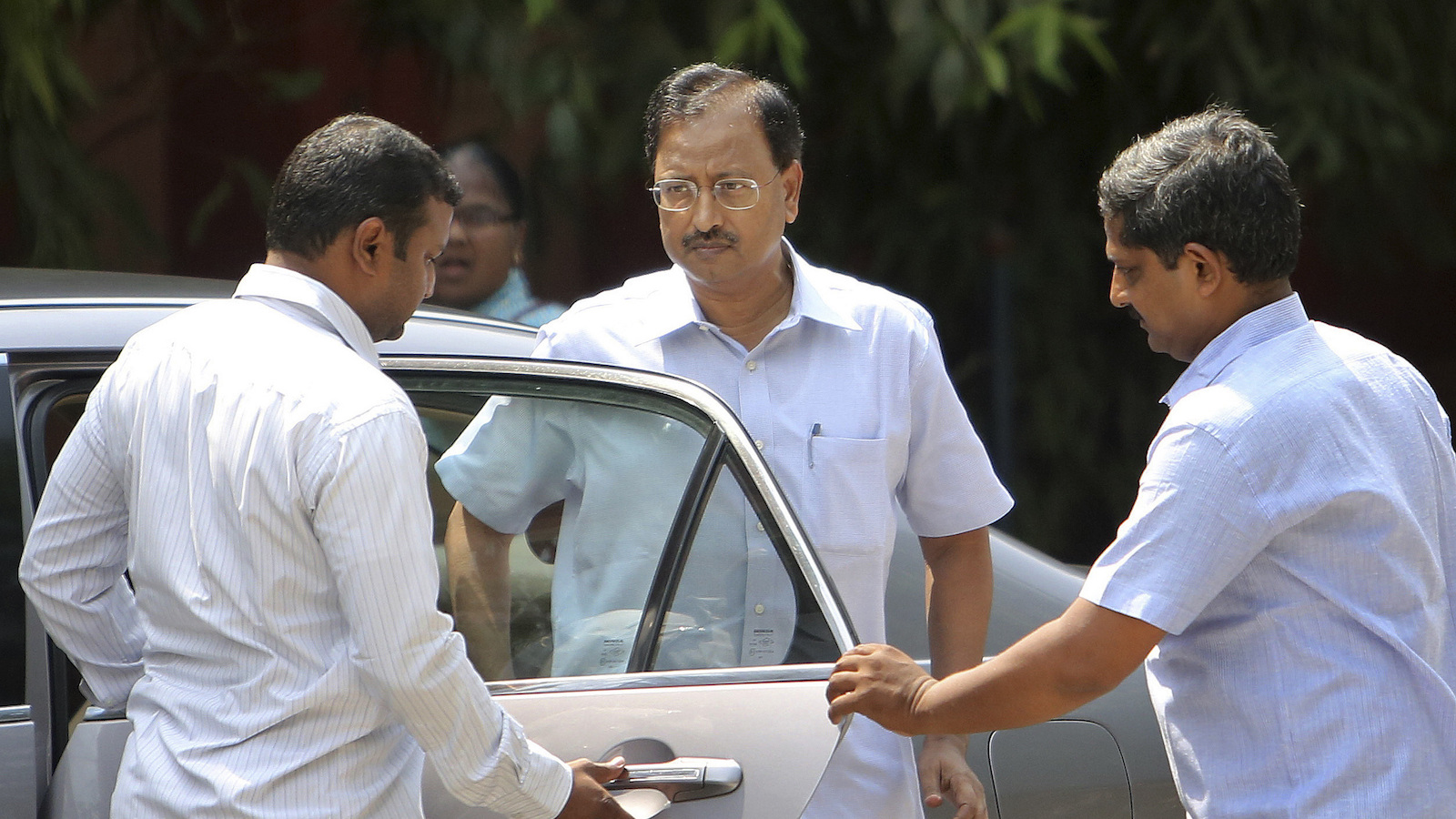 Satyam Computer Services founder B. Rama Raju, centre, arrives at a court in Hyderabad, India, Thursday, April 9, 2015. An Indian court on Thursday convicted Raju, the founder of the outsourcing giant and nine others on charges of stealing millions of dollars in one of the largest frauds in the country's corporate history.