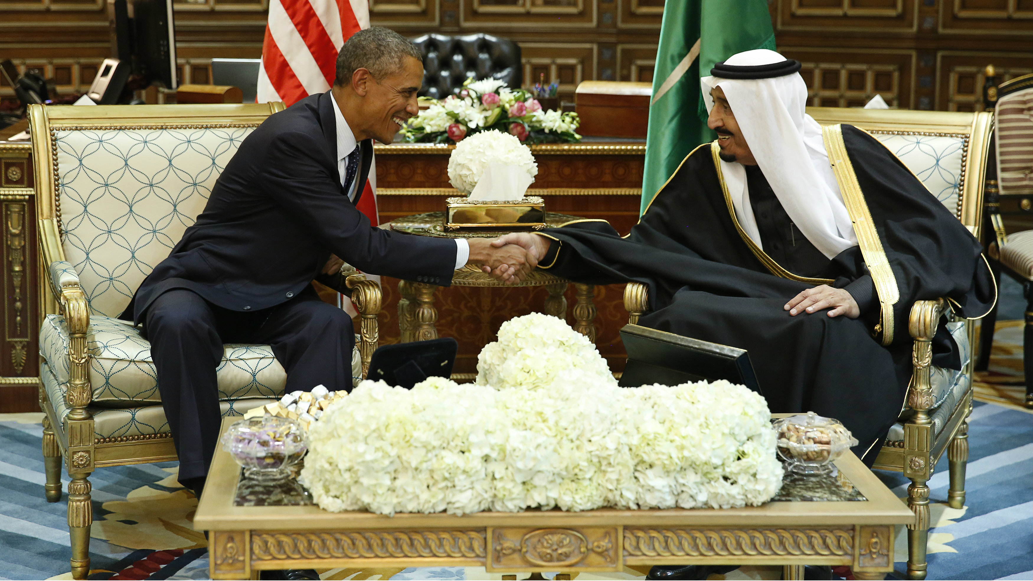U.S. President Barack Obama (L) shakes hands with Saudi Arabia's King Salman at the start of a bilateral meeting at Erga Palace in Riyadh January 27, 2015.
