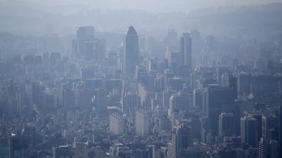The skyline of central Seoul is seen during a foggy day.