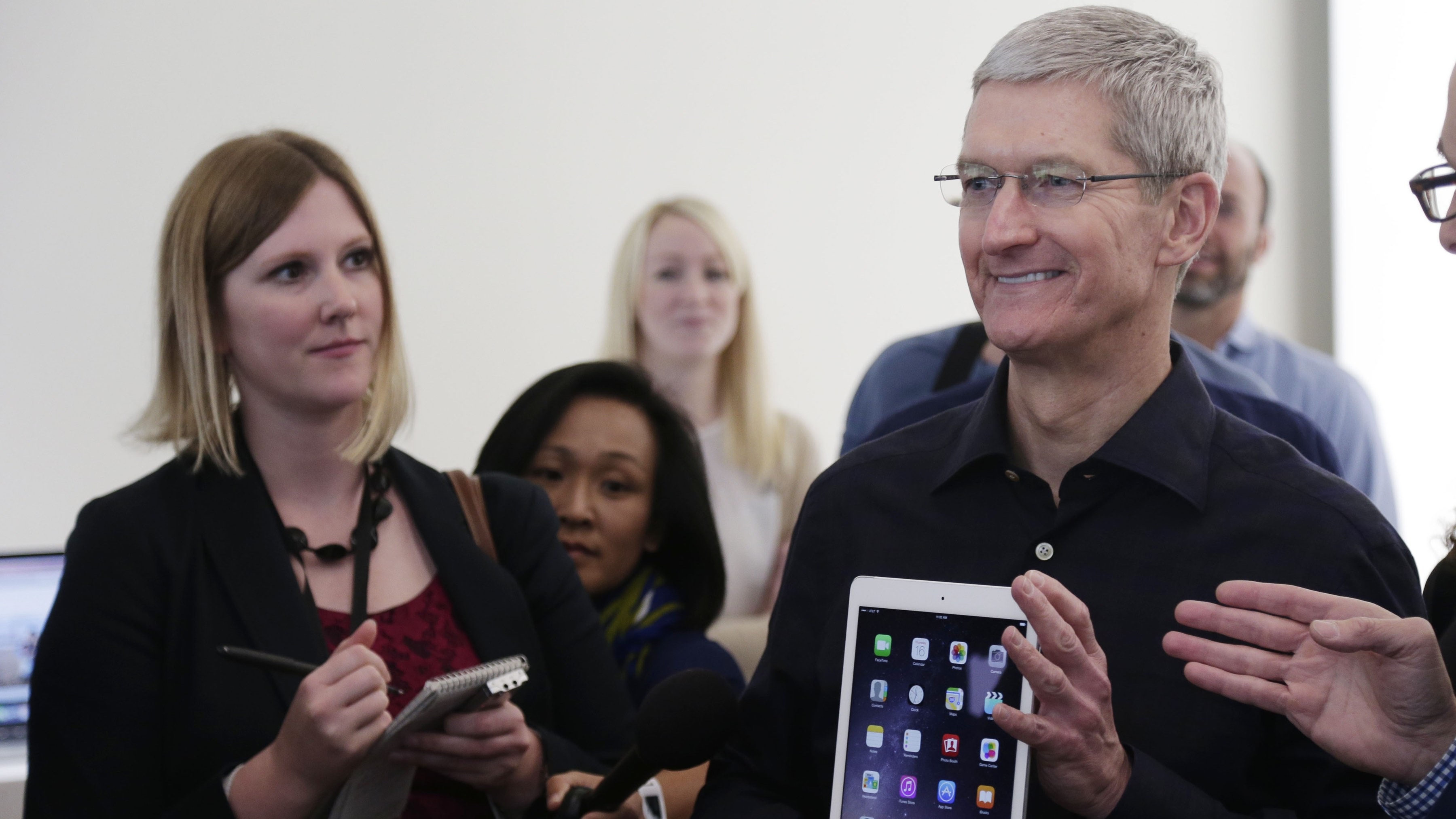 Apple CEO Tim Cook display the new iPad Air 2 at Apple headquarters on Thursday, Oct. 16, 2014 in Cupertino, Calif. Apple unveiled the thinner iPad with a faster processor and a better camera as it tries to drive excitement for tablets amid slowing demand. (AP Photo/Marcio Jose Sanchez)