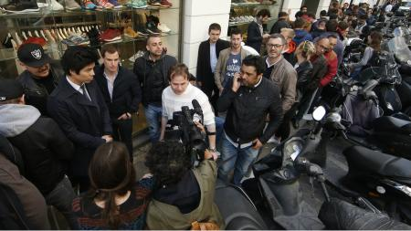 Customers queue up as they wait to buy the Apple Watch at a store in Paris, France, April 24, 2015.