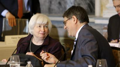 U.S. Treasury Secretary Jack Lew (R) and Federal Reserve Board Chair Janet Yellen (L) talk at the end of a Financial Stability Oversight Council meeting.