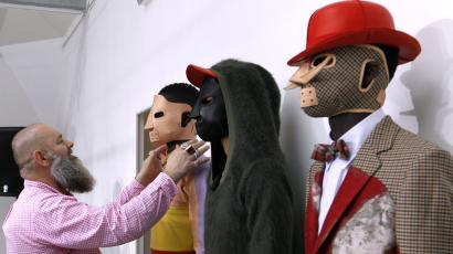 Belgian designer Walter Van Beirendonck (L) gives instructions to models before presenting his creations during the Autumn-Winter 2012/2013 ready-to-wear men's fashion collection show on January 21, 2012 in Paris.