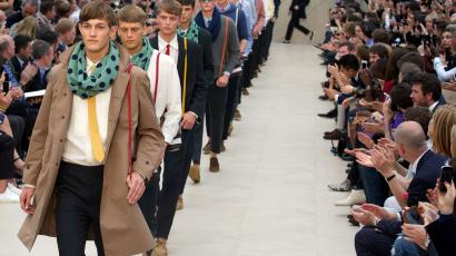 Models present creations by Burberry Prorsum during the Spring/Summer 2014 London Collections: Men fashion event in London on June 18, 2013.