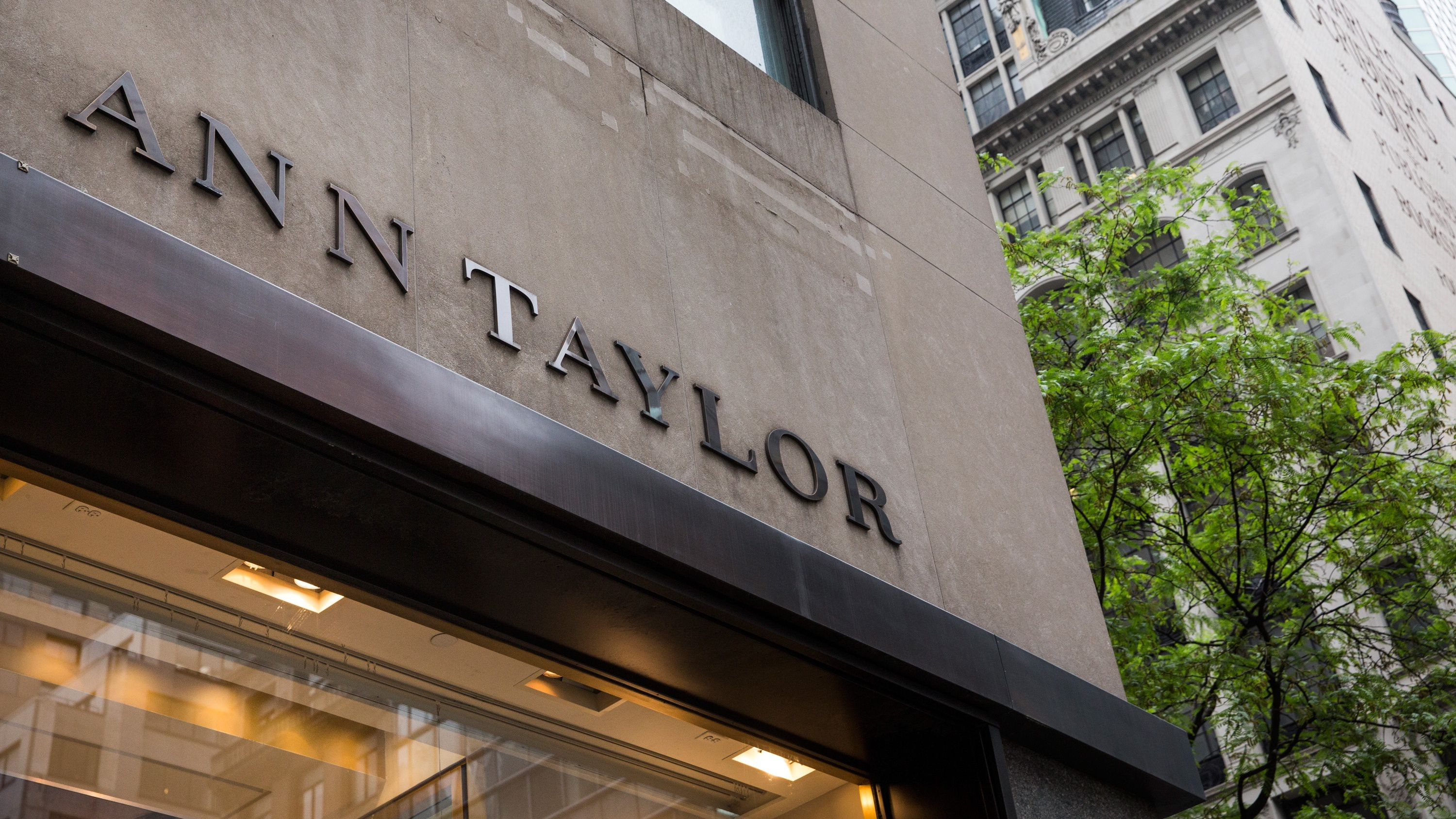 A sign for an Ann Taylor clothing store in Manhattan on May 18, 2015 in New York City. Ascena Retail Group which owns Lane Bryant and Dressbarn, announced it is purchasing Ann Taylor and Loft retail stores for $2.16 billion to expand its women's apparel business.