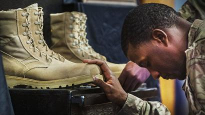 A U.S. soldier pays his respects at Bagram Air Field.