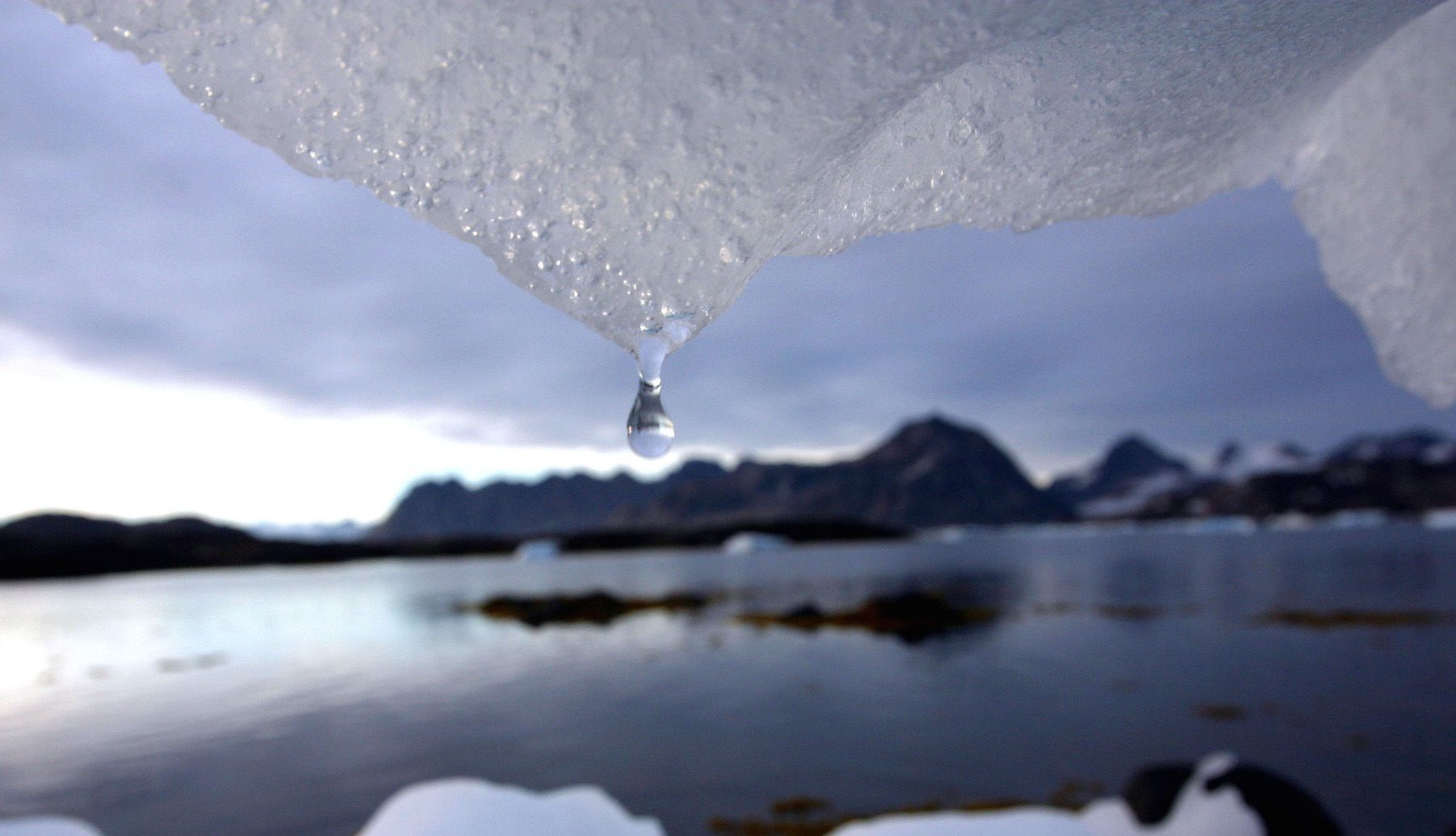 An iceberg melts in Kulusuk, Greenland near the arctic circle Tuesday Aug, 16, 2005. Scientists say that global warming has an increasing effect on the Arctic region with glaciers shrinking, temperatures of the arctic waters warming, and permafrost softening. (AP Photo/John McConnico