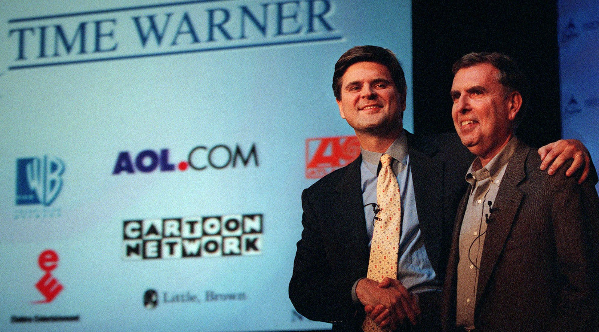 America Online's chairman and chief executive, Steve Case, left, and Time Warner's chairman and chief executive, Gerald Levin, shake hands before a news conference Monday, Jan. 10, 2000, in New York. Time Warner, the world's largest media and entertainment company, is being acquired by America Online for about $166 billion in stock in what would be the biggest corporate merger ever.