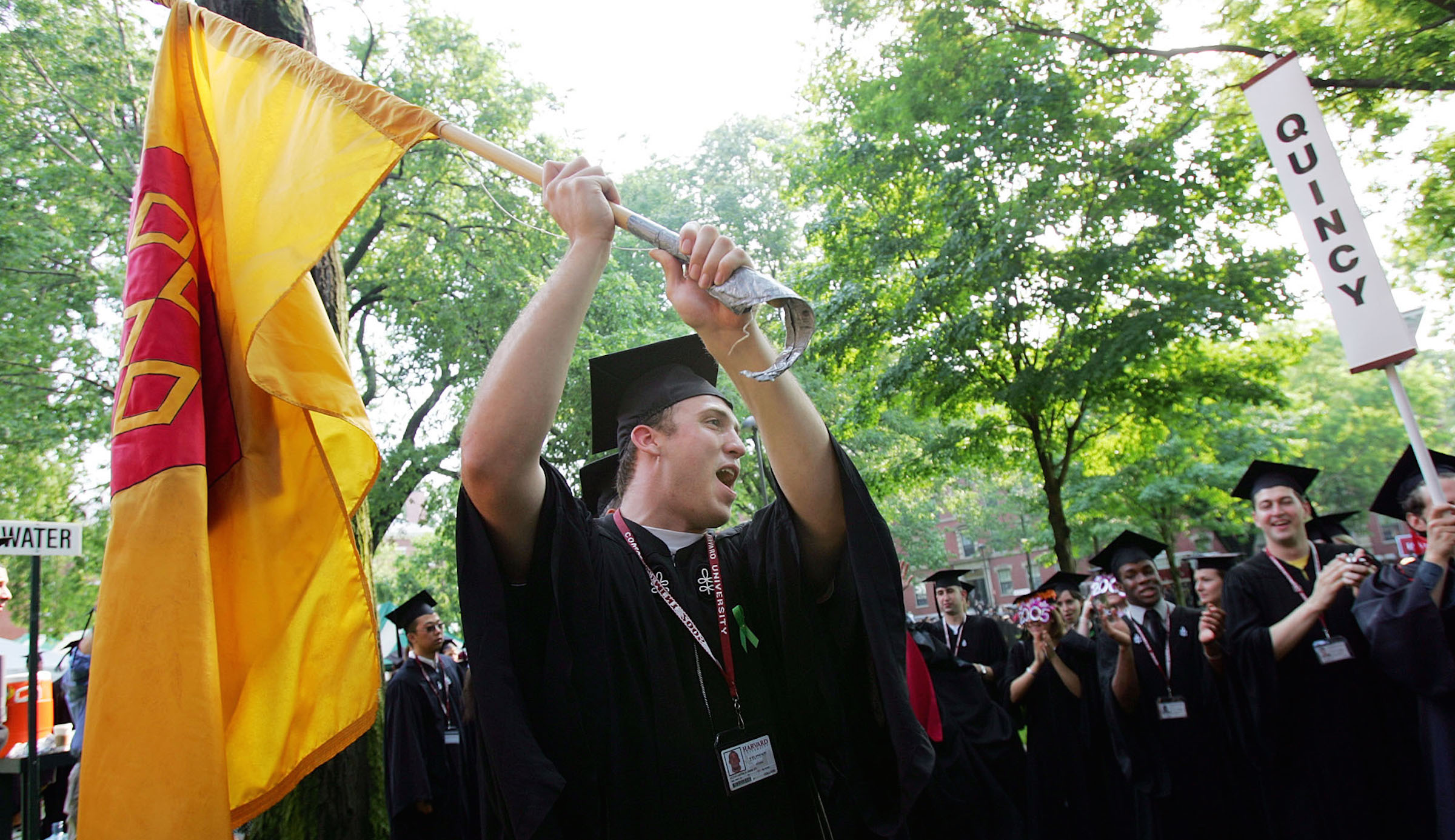 Elias Shibley, Harvard University class of 2005, flies a Quincy House flag when a procession of  Harvard's 354th commencement ceremonies began, Thursday, June 9, 2005, in Cambridge, Mass. (AP Photo/Chitose Suzuki)