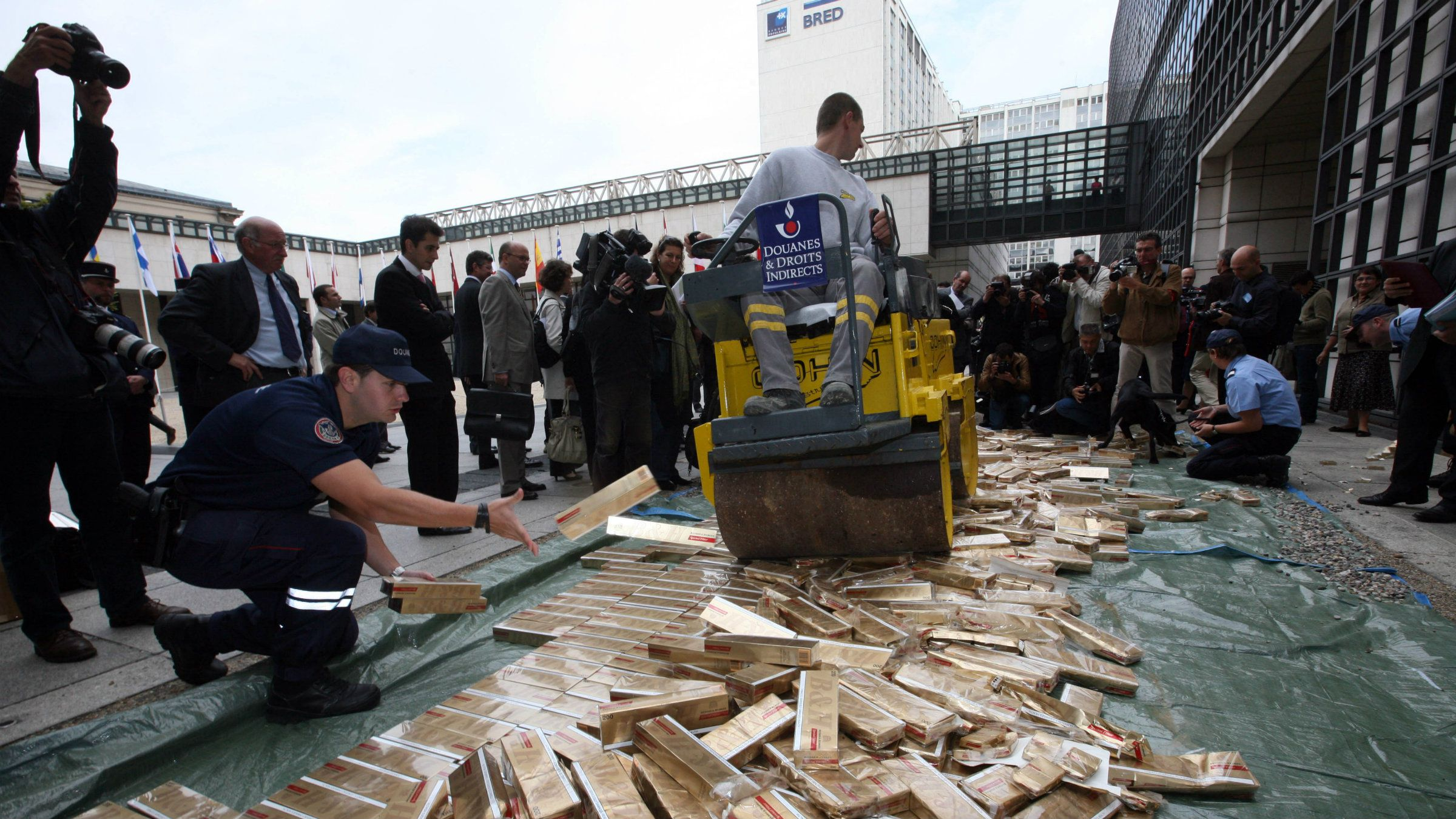Some thousands of contraband cigarettes are crushed, outside the finance ministry in Paris.