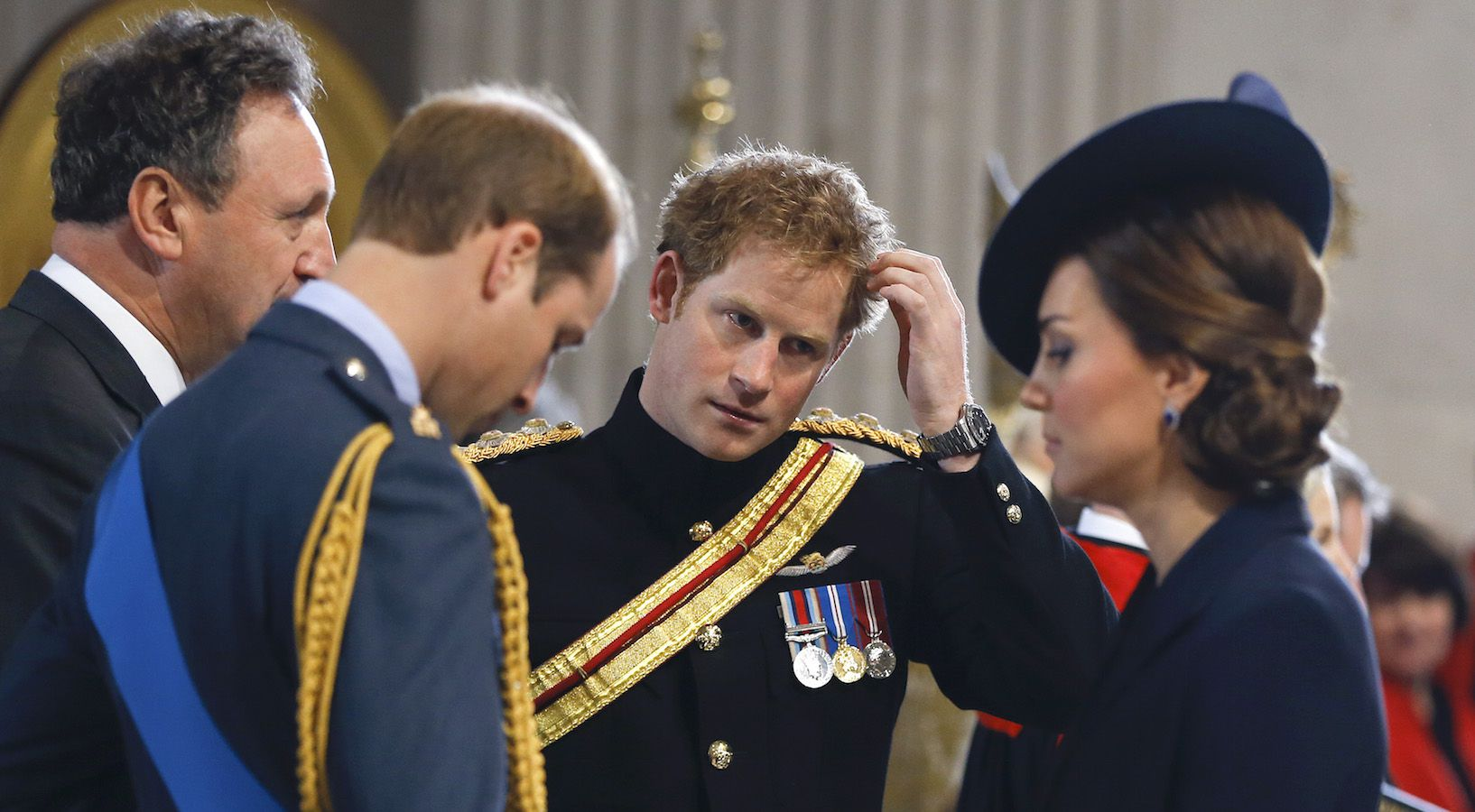 Britain's Prince Harry, center, stands with Prince William, left, and Kate, the Duchess of Cambridge as they arrive to attend the Service of Commemoration – Afghanistan, at St Paul's Cathedral in London, Friday, March 13, 2015. The Queen and Britain's prime minister are joining veterans in a service to commemorate the end of Britain's combat operations in Afghanistan. Prince William, his pregnant wife Kate, and Prince Harry — who served two tours during the conflict — will also attend the ceremony to remember the war dead. Almost 150,000 Britons served in the conflict, and 453 died. (AP Photo/Kirsty Wigglesworth, pool)