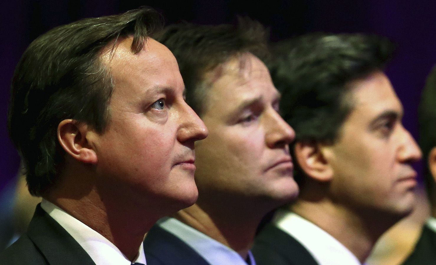 Britain's Prime Minister David Cameron, with Deputy Prime Minister Nick Clegg and Leader of the opposition Labour Party, Ed Miliband attend a Holocaust Memorial Day ceremony at Central Hall Westminster, Tuesday Jan. 27, 2015, in London.  The event in London with invited guests and dignitaries marks the International Holocaust Remembrance Day and commemorates the 70th anniversary of the liberation of the Nazi Auschwitz death camp. (AP Photo / Chris Jackson, Pool)