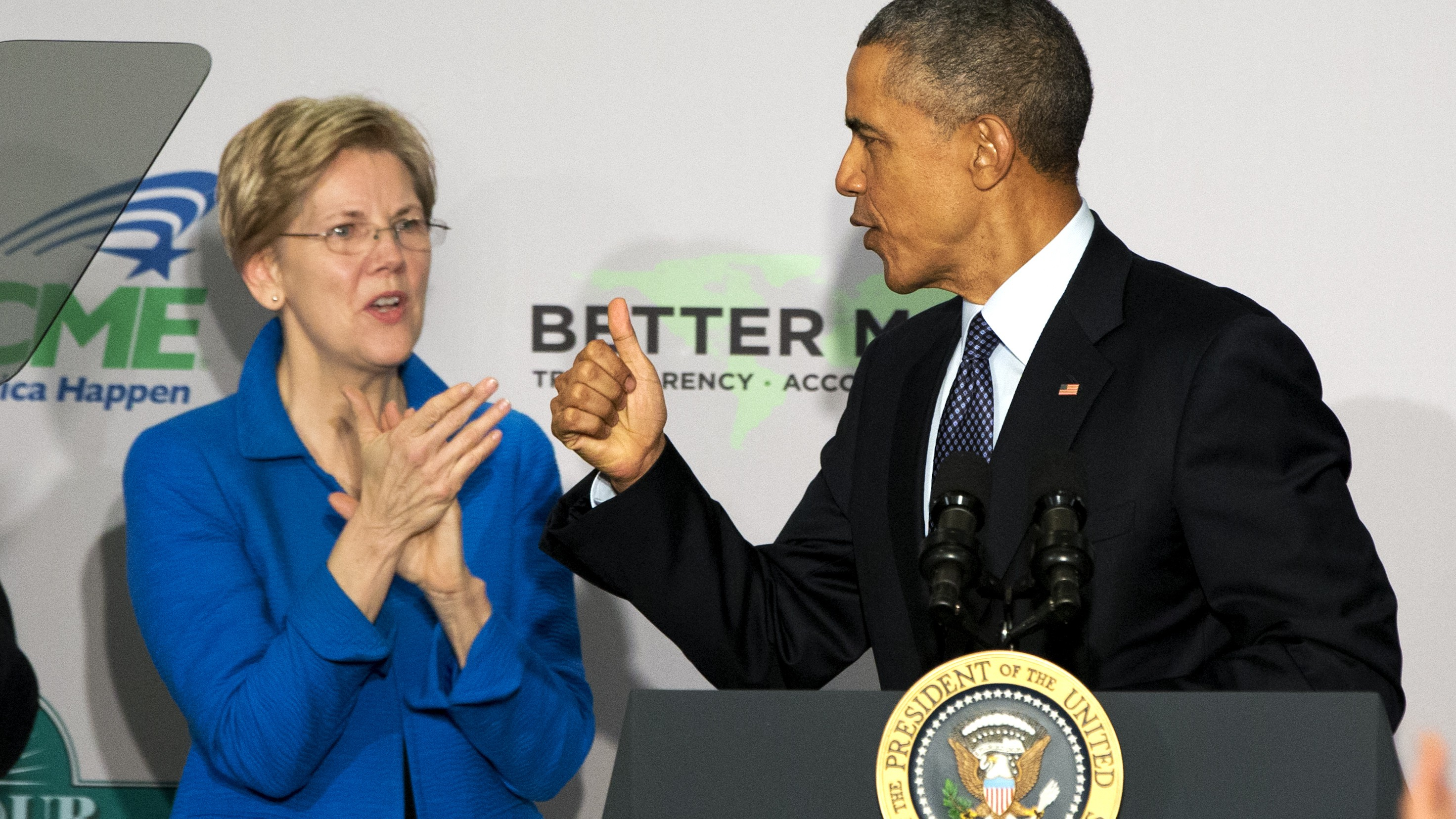 "FILE - In this Feb. 23, 2015, file photo, Sen. Elizabeth Warren, D-Mass. applauds as President Barack Obama makes the thumbs up sign as he arrives to speak at AARP in Washington. When Obama huffed that Warren was a ""politician like everybody else"" he revealed a rift that predates the current hostilities between the two Democrats over trade. Though occasional allies, Warren has been aggravating the Obama administration since her pre-Senate days when she chaired an oversight panel charged with being a watchdog over the massive federal bank bailout."